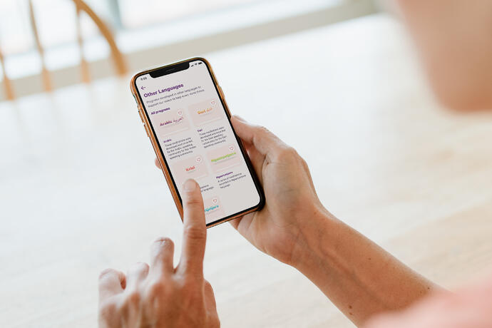 explore-OtherLanguage-iphoneonhand